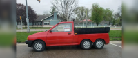 A Six Wheeled Ford Festiva Hatchback Made Pickup is For Sale in Wisconsin